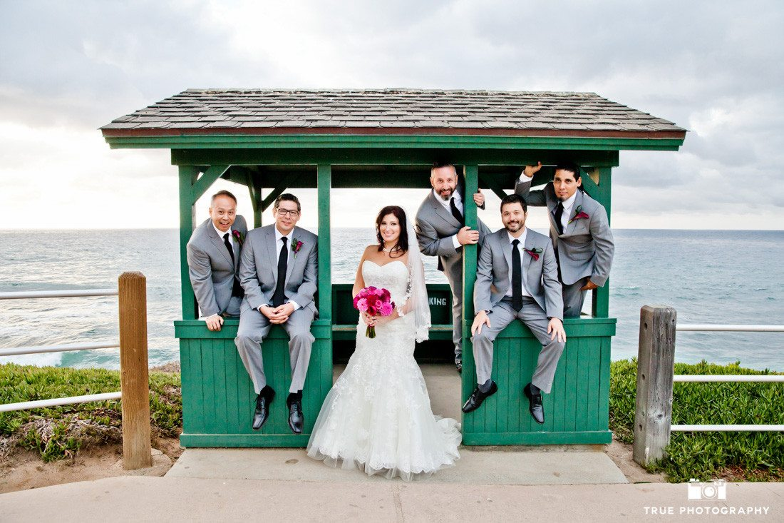 Bride posed with fun groomsmen bridal party at La Jolla Cove