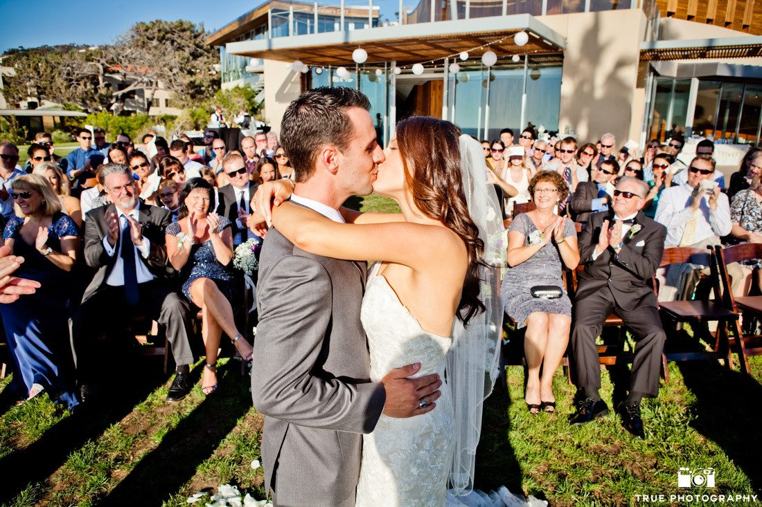 Bride and groom kissing at ceremony