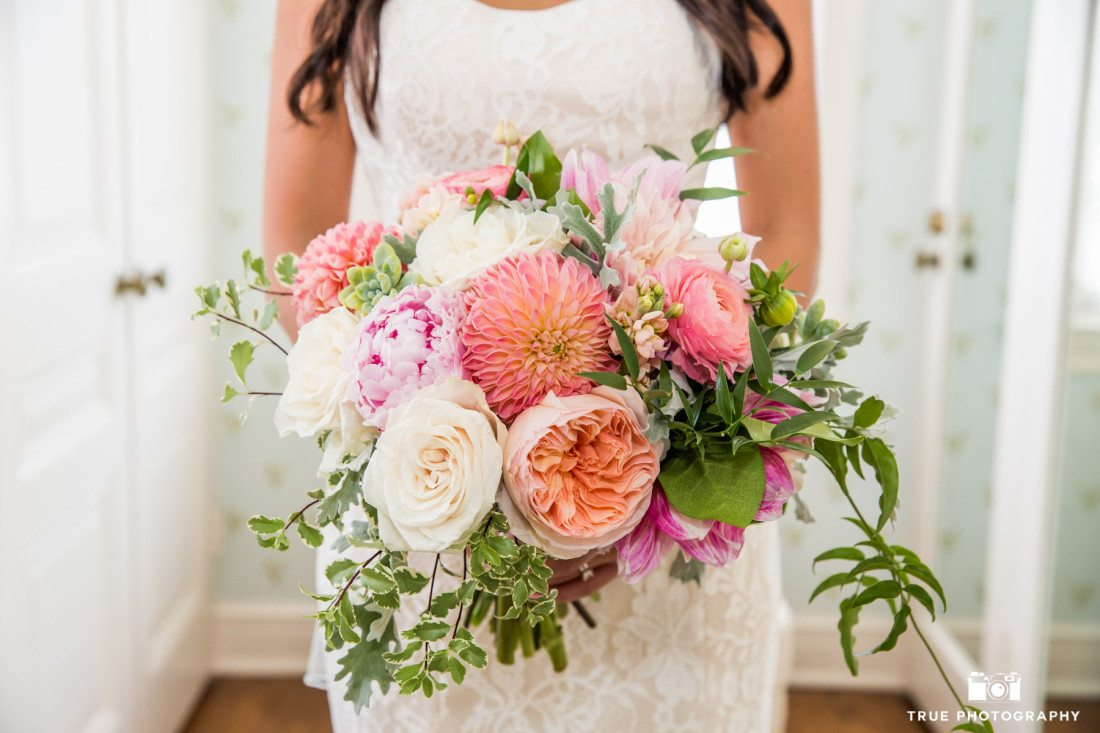Photograph of bride holding bouquet at the Darlington House in La Jolla, Califronia.