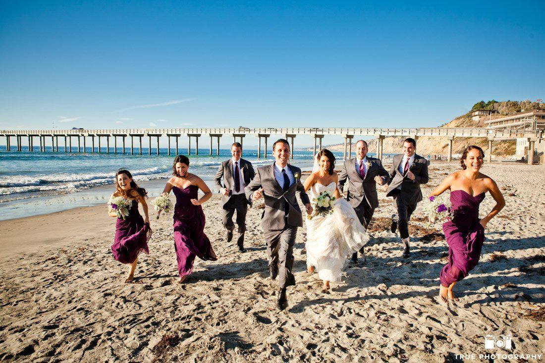 Bride, groom, and the bridal party running