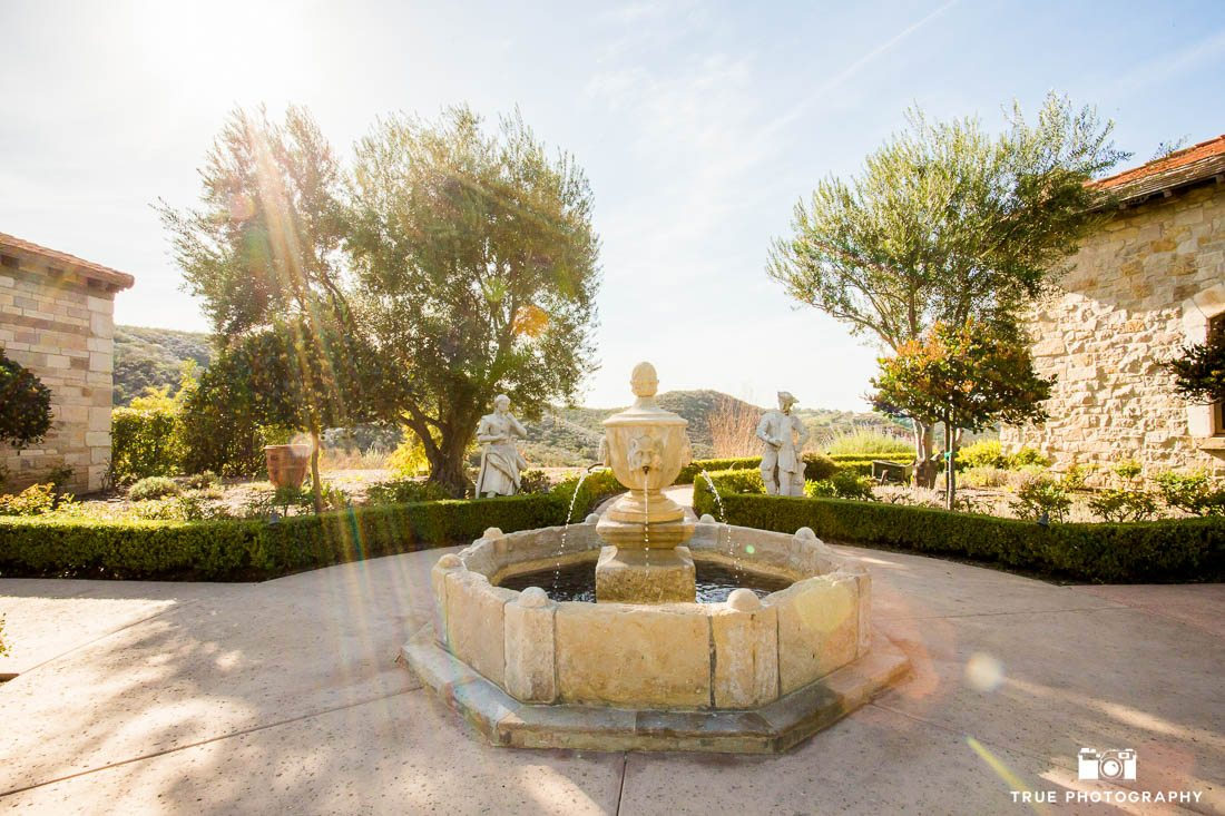 fountain with sun flare at exclusive wedding venue cal-a-vie