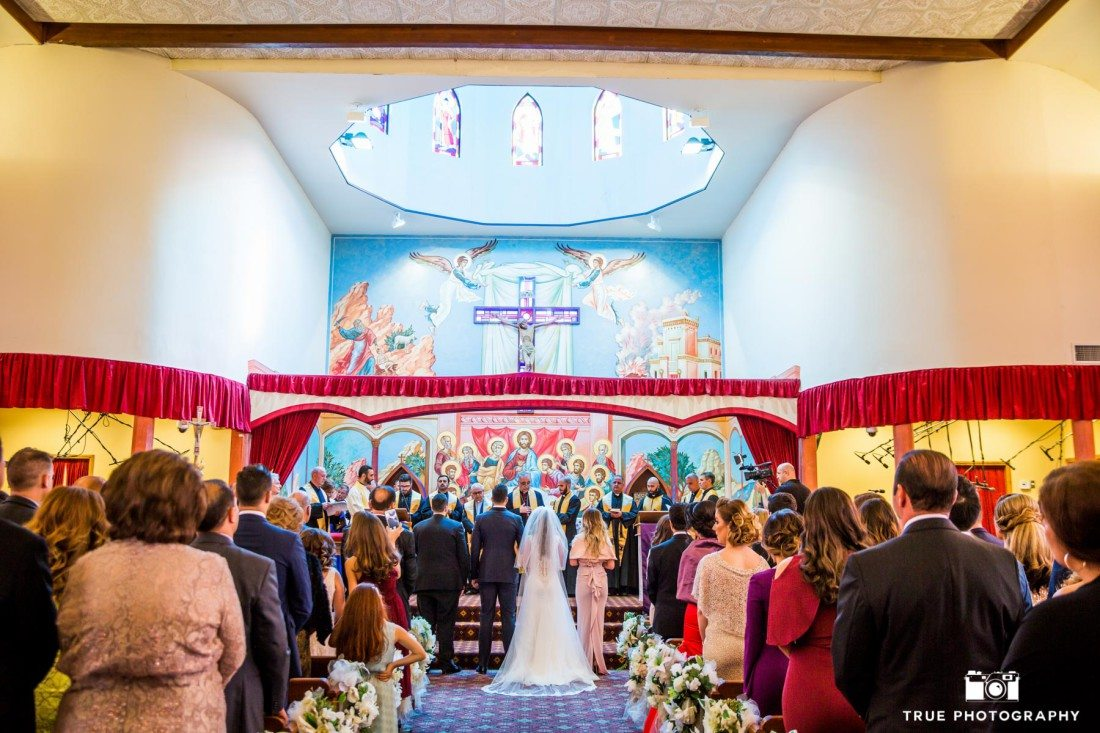 Couple stand at altar of Chaldean church after bride walks down aisle