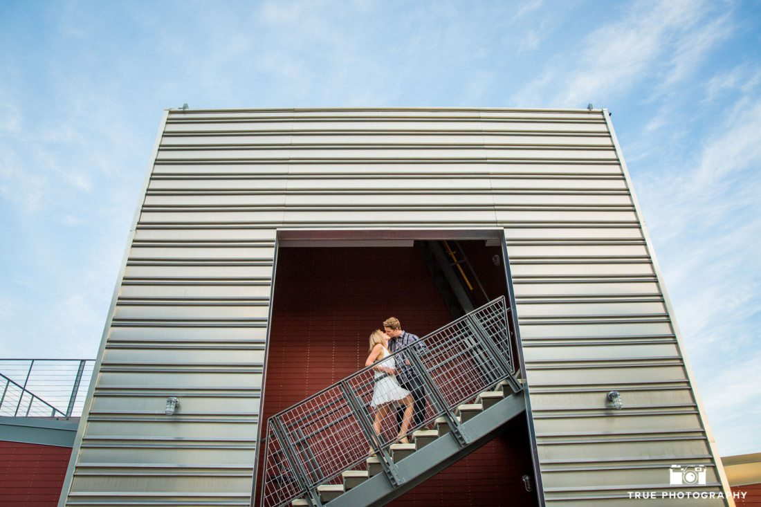 Cool engagement photo of couple on a staircase with leading lines in Point Loma, San Diego