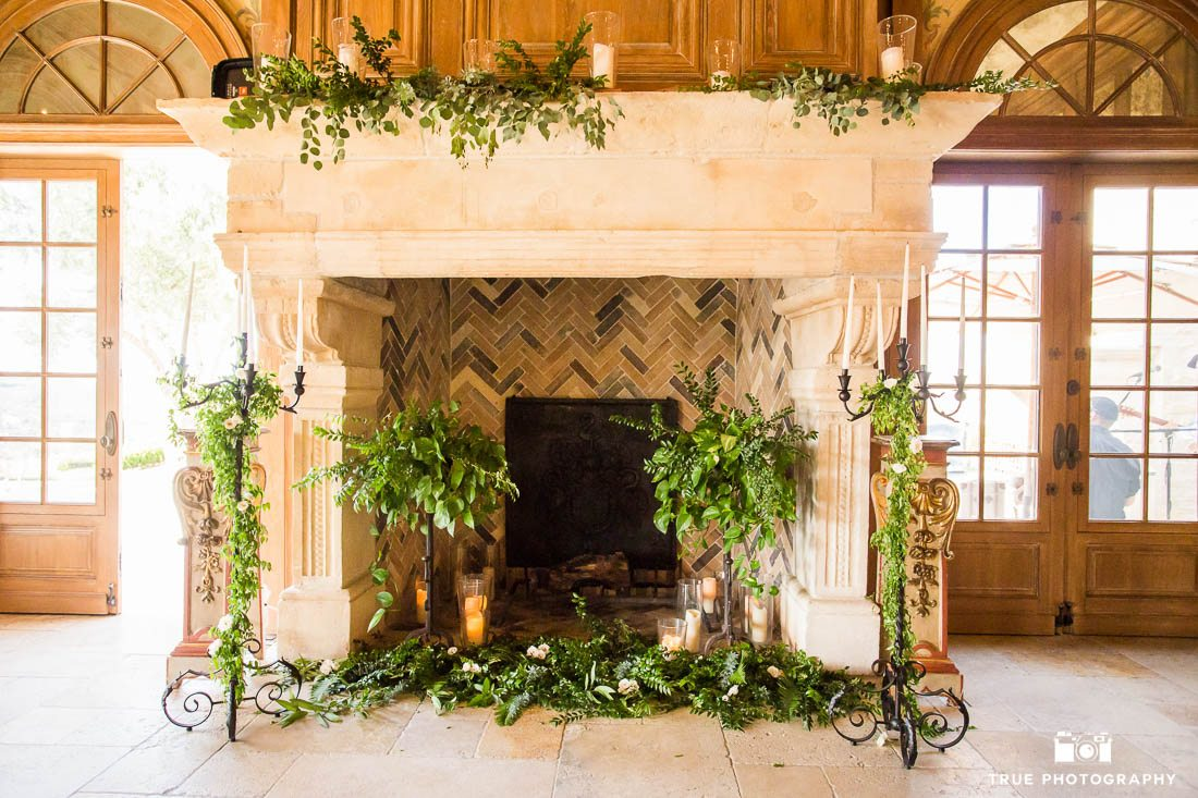 Eucalyptus details on fireplace at wedding