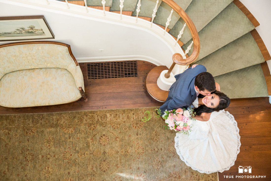 Overhead wedding photo at the staircase of the Darlington House in La Jolla, California