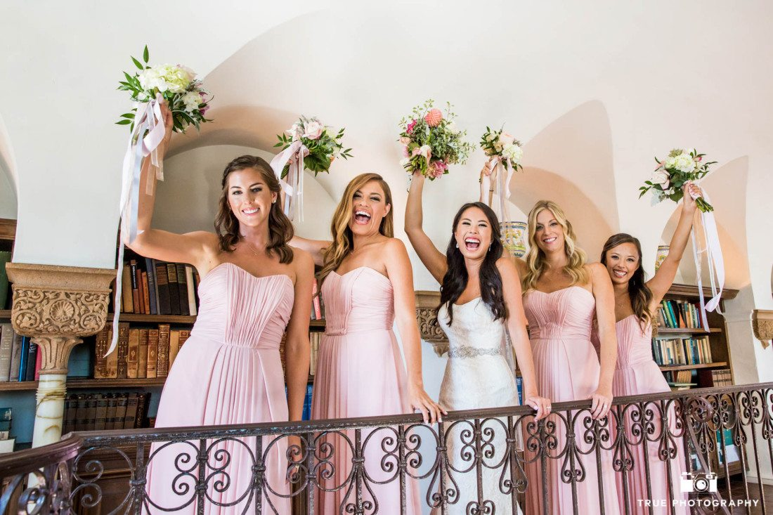 Bridesmaids in a fun wedding photo at the Darlington House Library