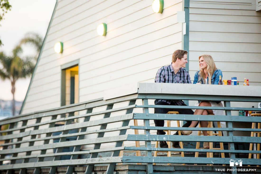 Candid engagement photo at Mitch's Seafood Restaurant in Point Loma, San Diego