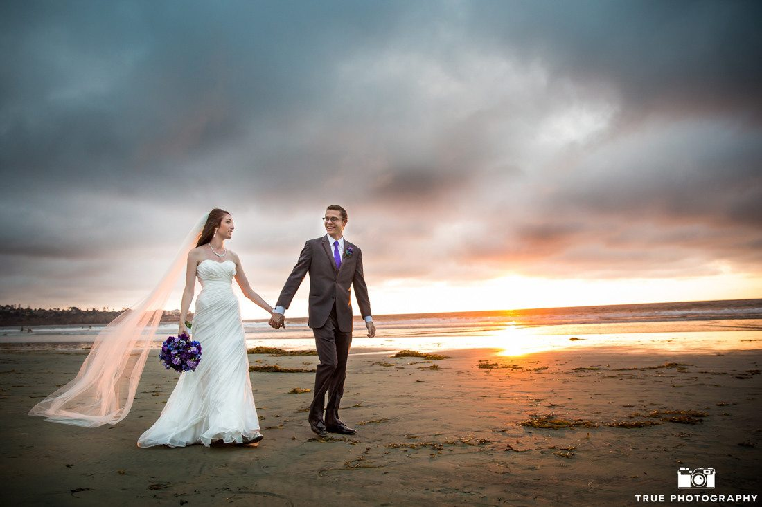 Bride and groom portrait by the beach
