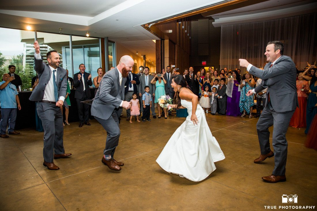 Bride and groom dancing at Scripps Seaside Forum