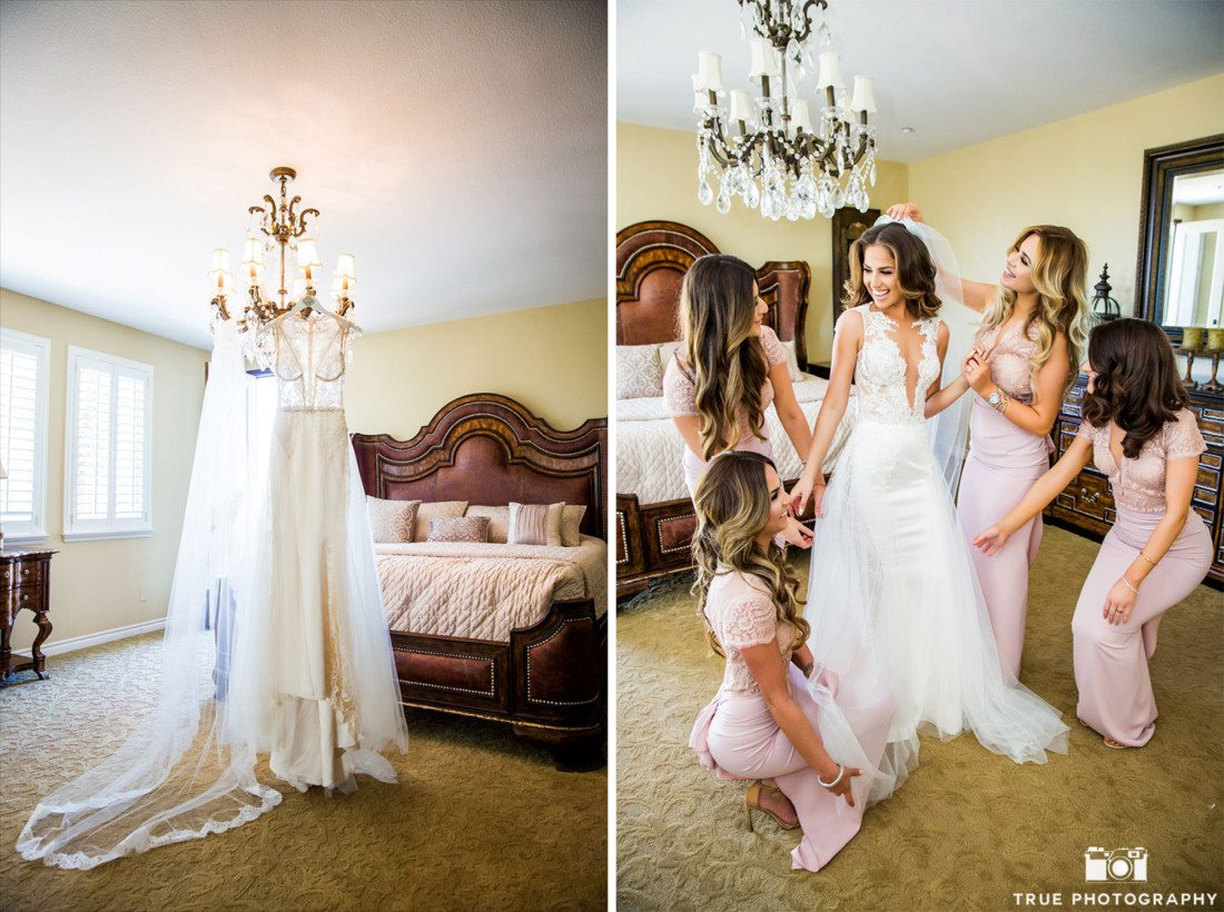 Bride has help from bridesmaid as she prepares for wedding ceremony