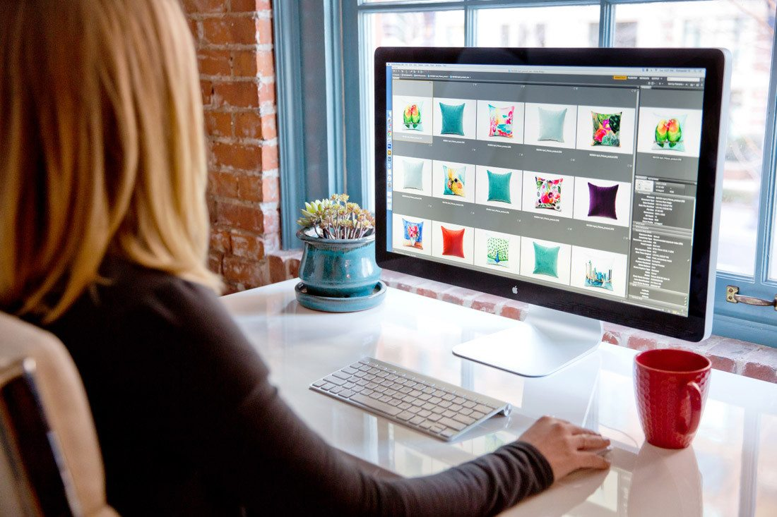 Sitting at computer for post production on arelor.com product photography