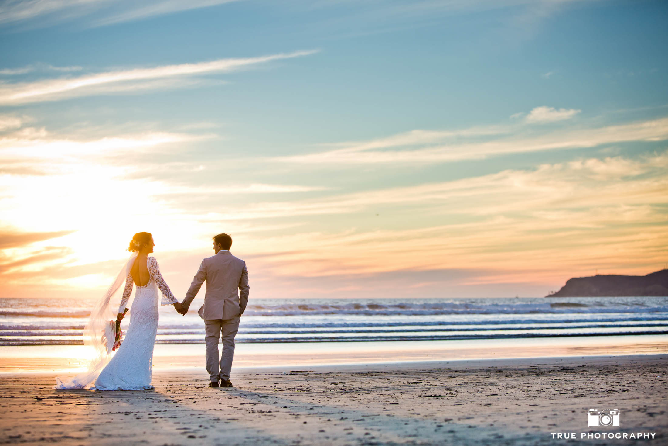 Sunset newlyweds portrait on the beach at Coronado Island