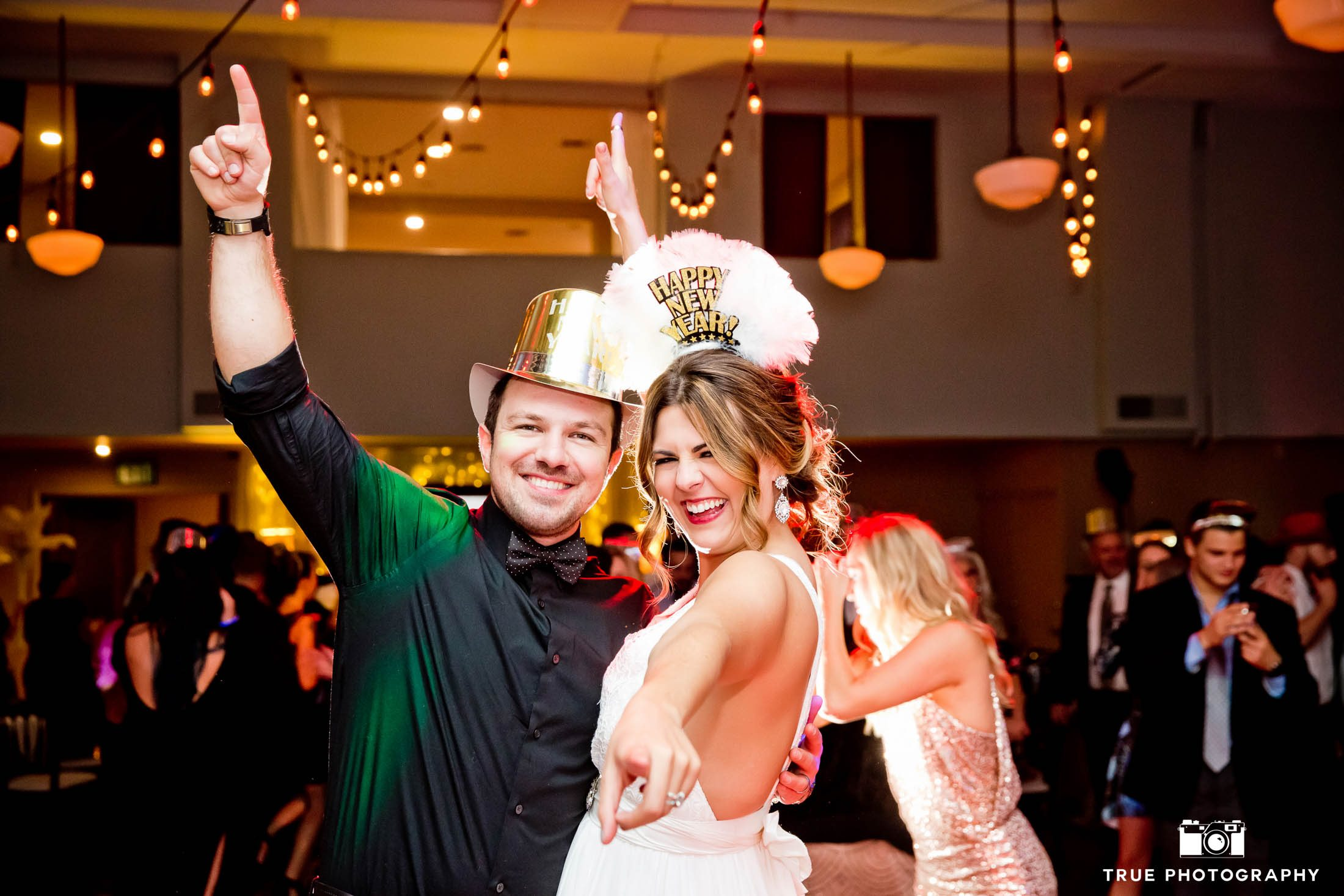 Bride and Groom celebrate during new year's eve wedding