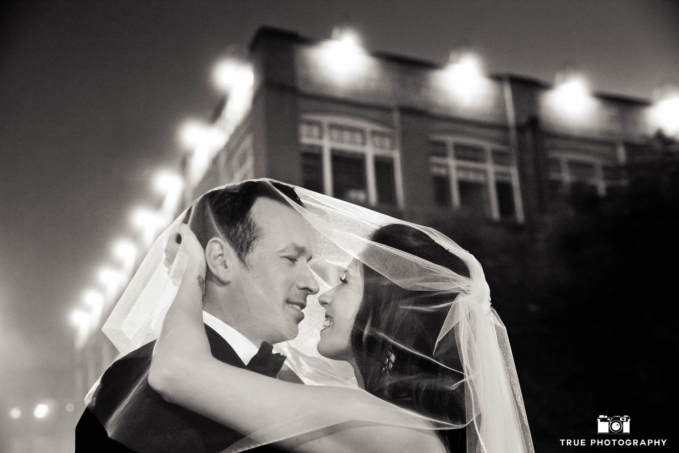 Foggy night shot of bride and groom