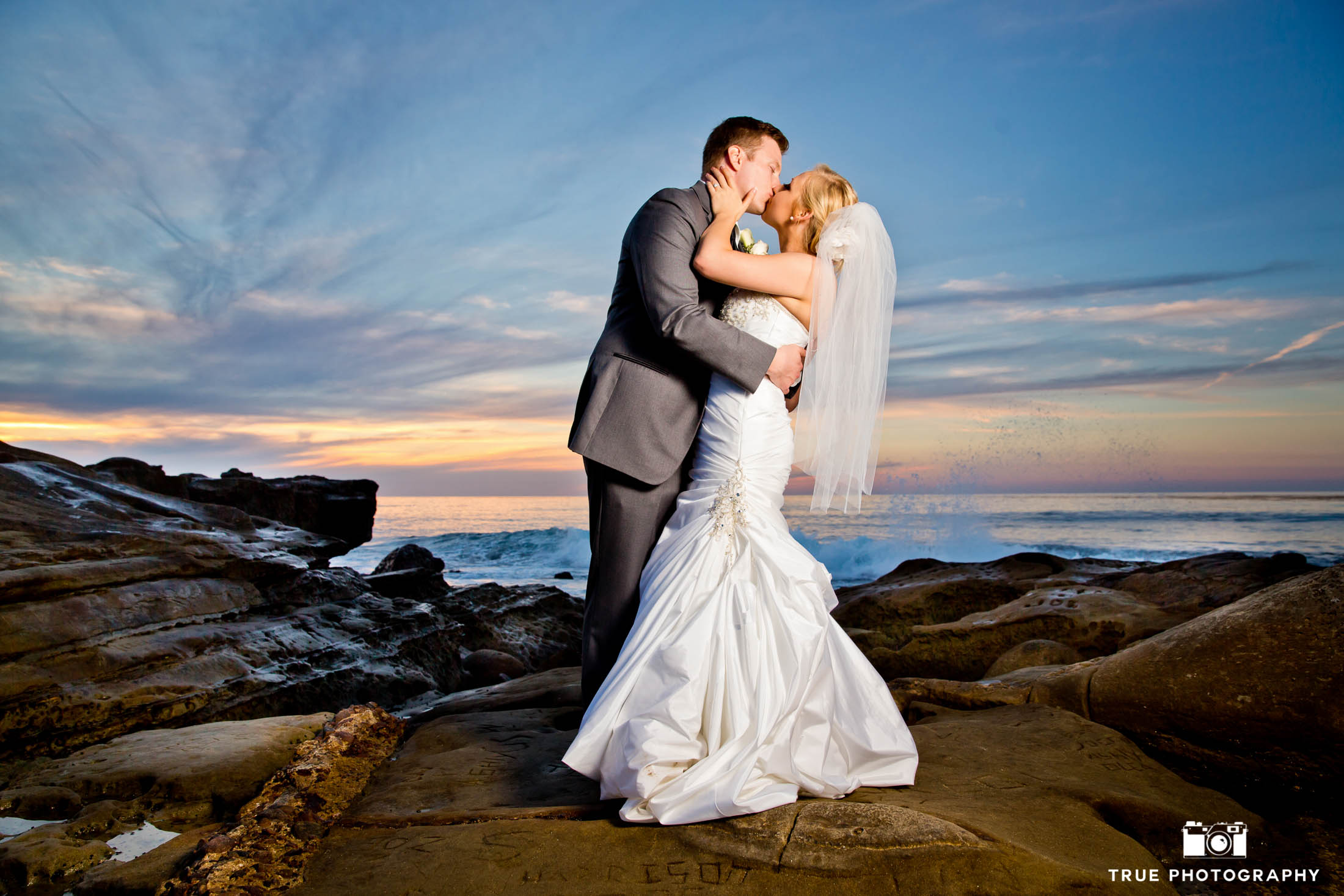 San Diego sunset with newlyweds taking night shot portraits