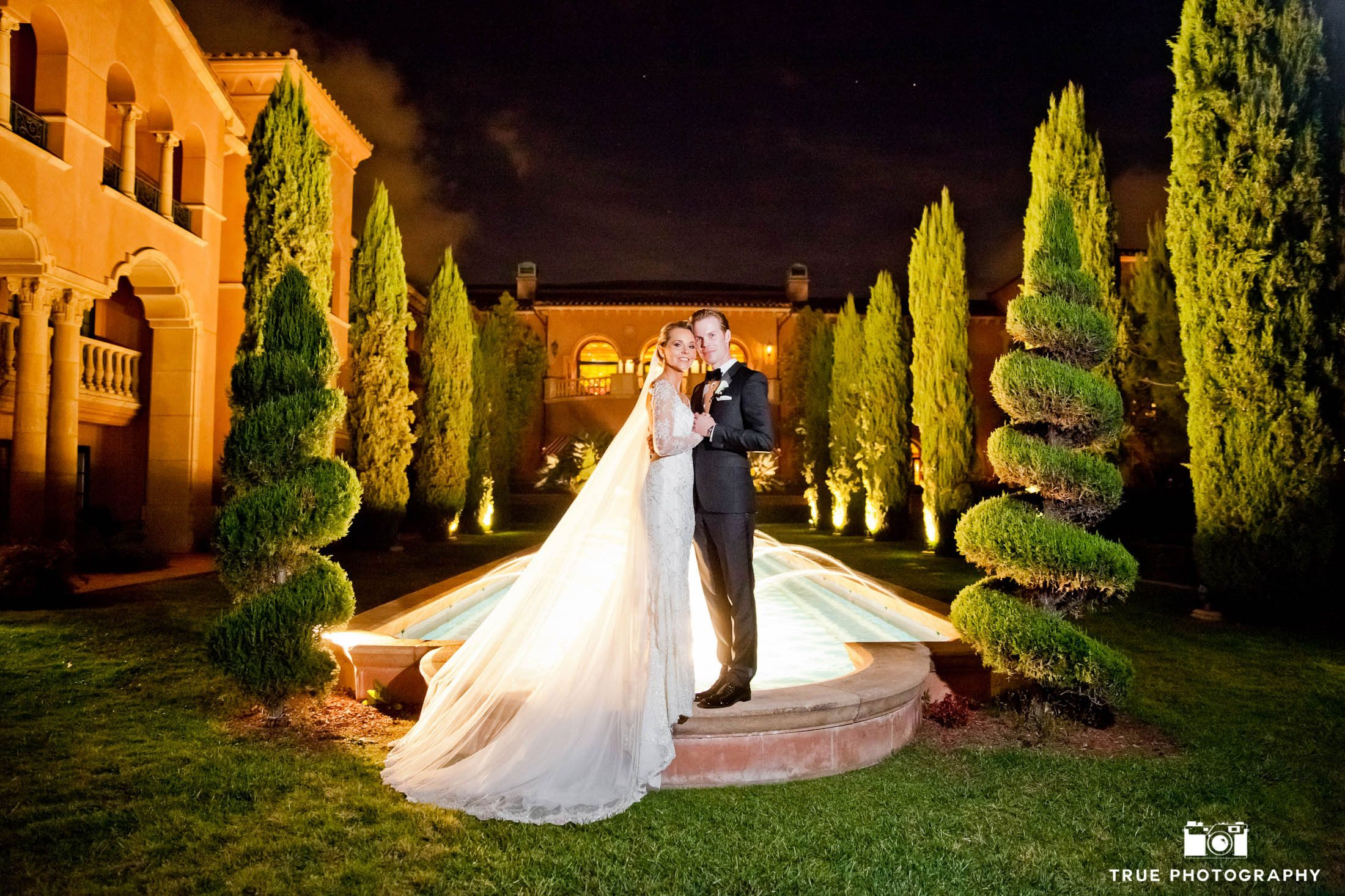 Night shot portrait of wedding couple at Fairmont Grand Del Mar