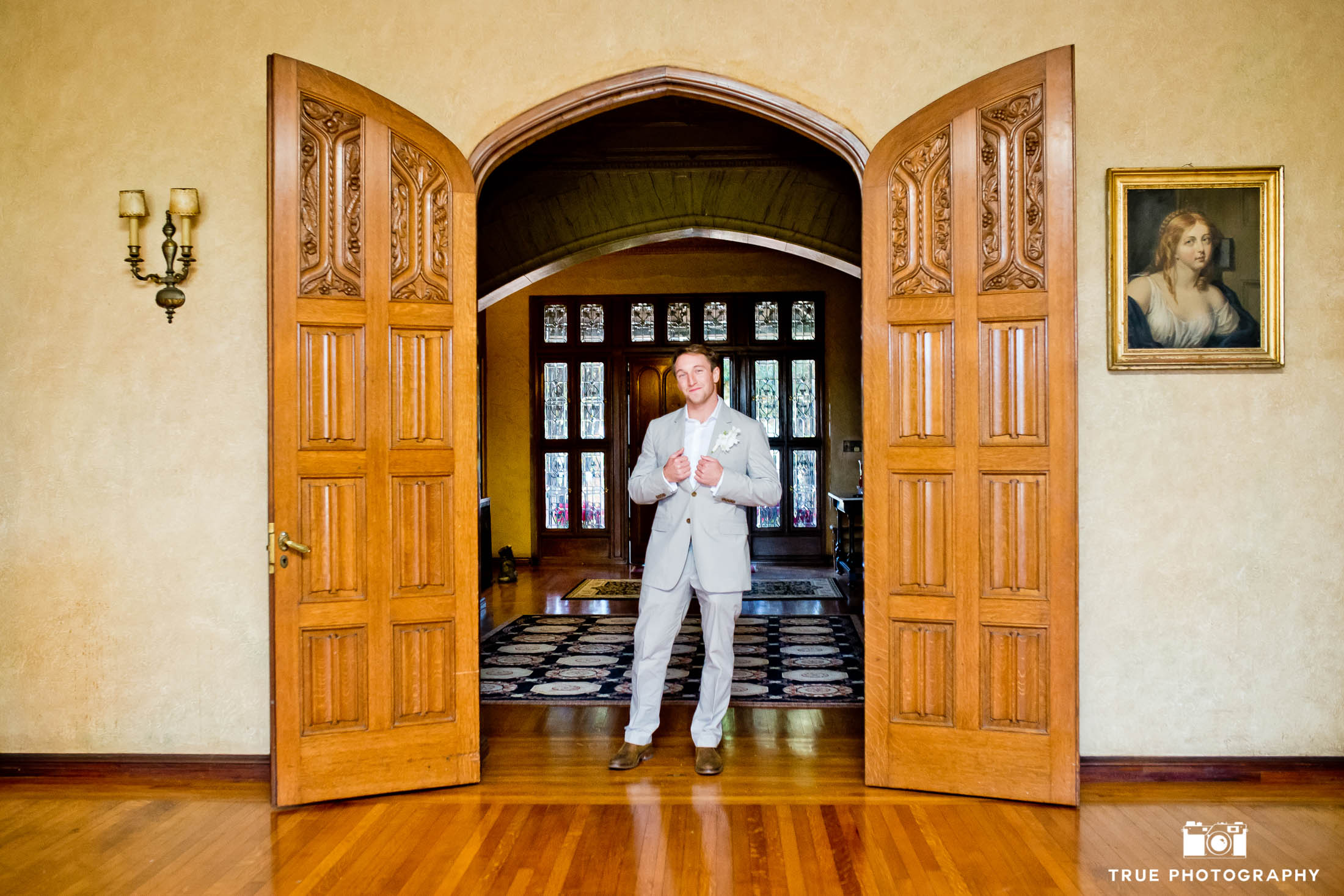 Grand Historical Mansion portrait of groom inside archway
