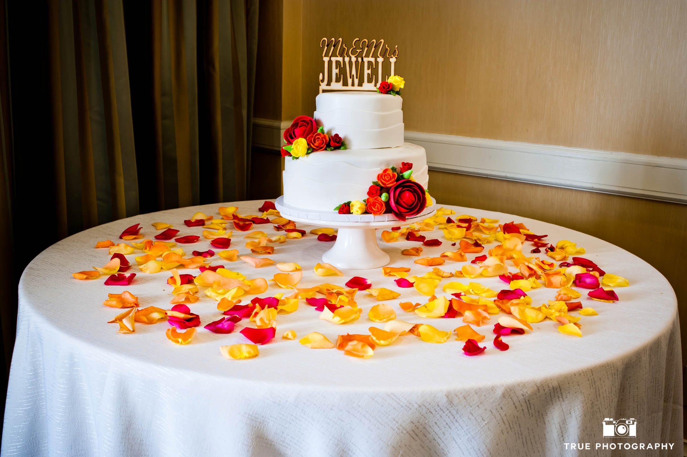 Minimal red and yellow cake with gold text cake topper