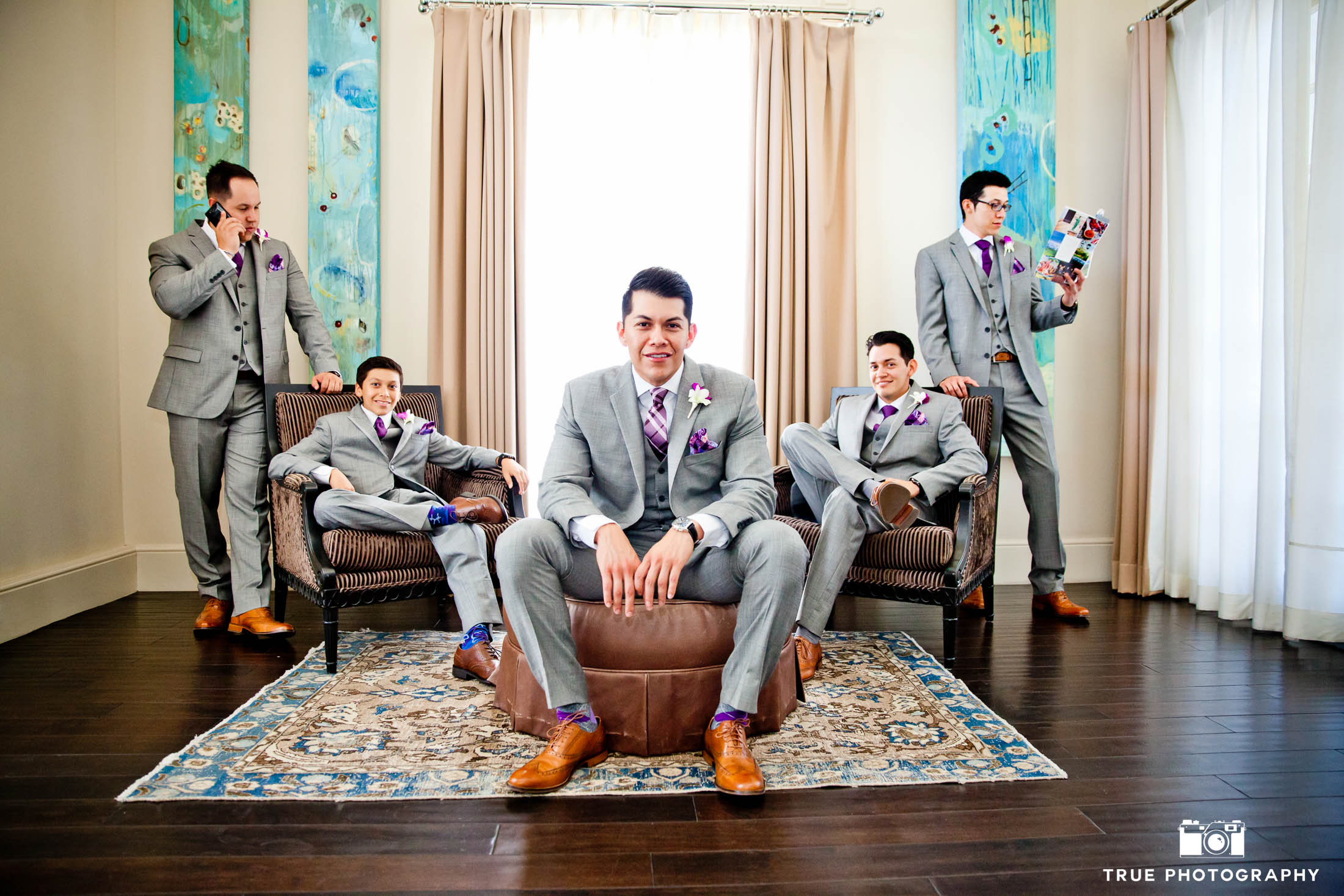 Groomsmen sit in lobby