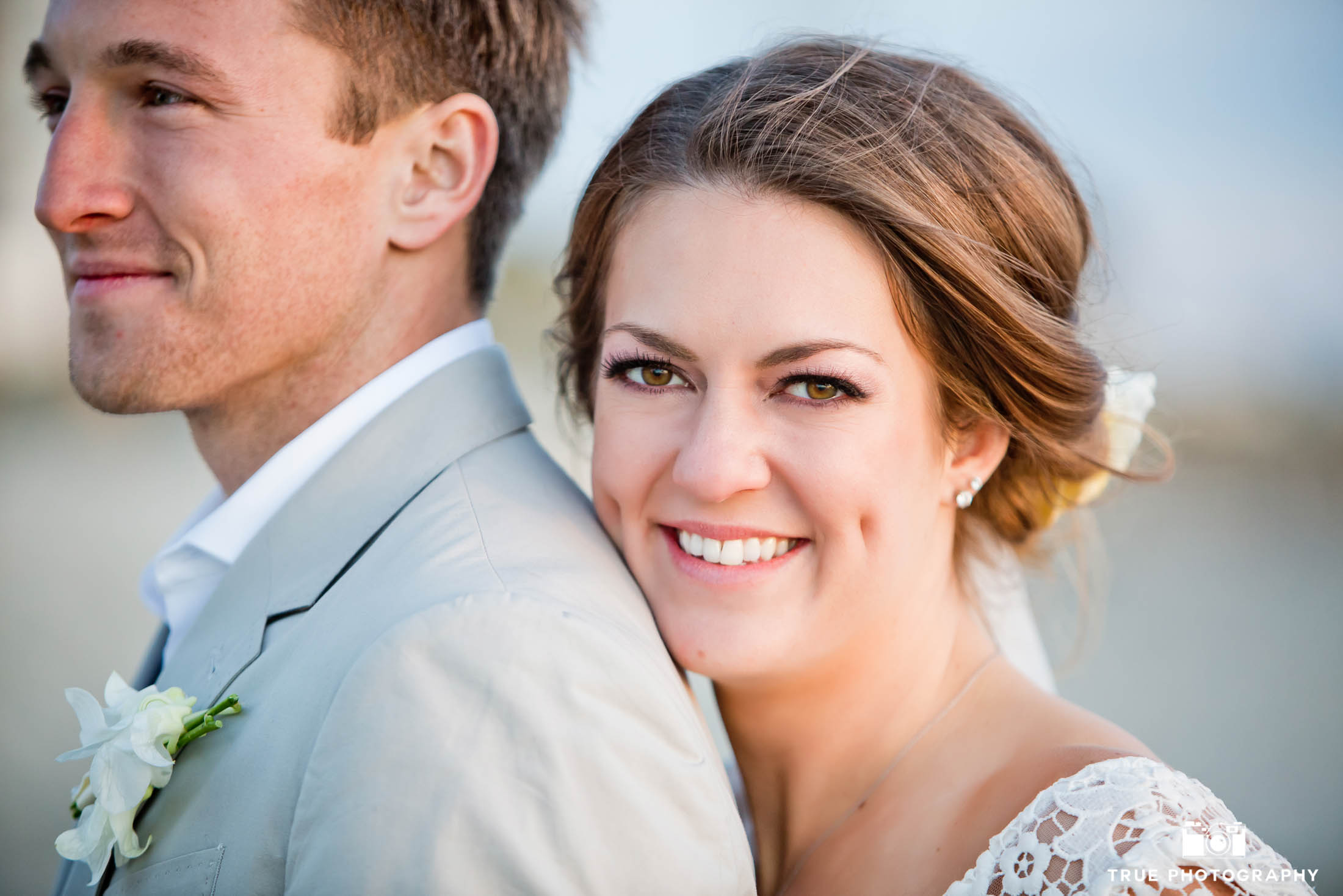 Coronado beach bride and groom closeup portrait