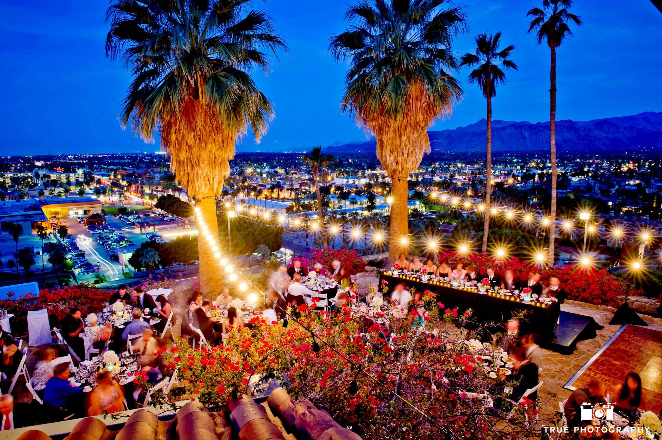 Aerial view of outdoor reception overlooking city lights