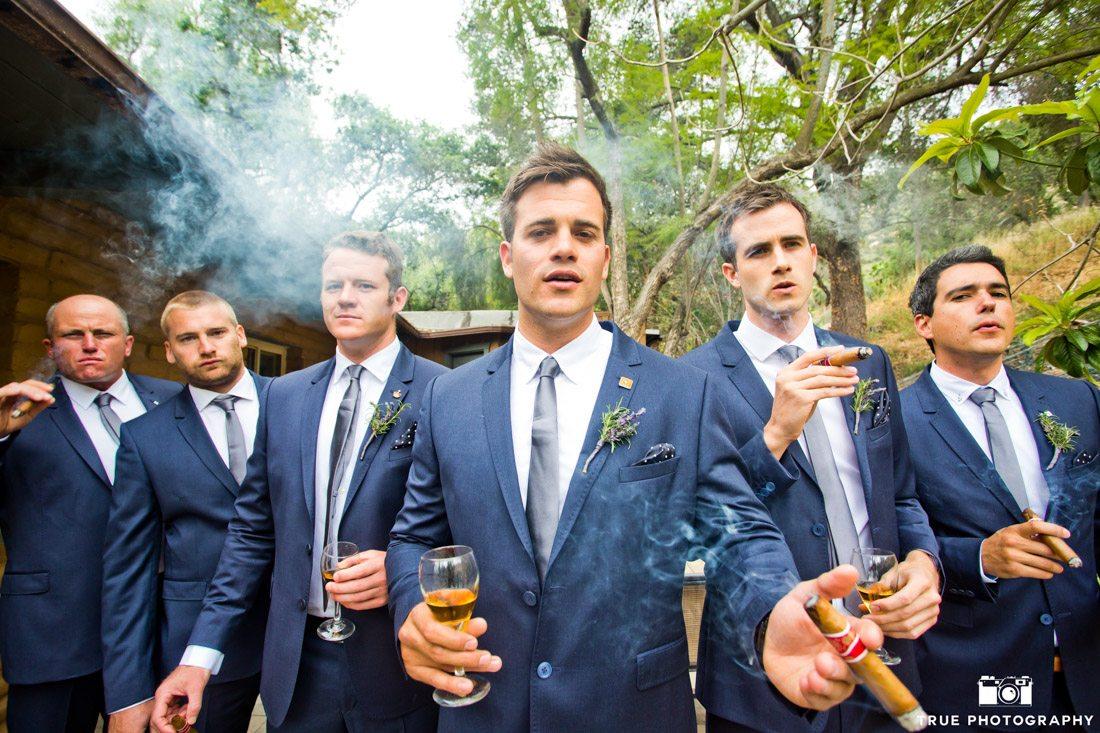 Groomsmen wearing blue smoking sigars