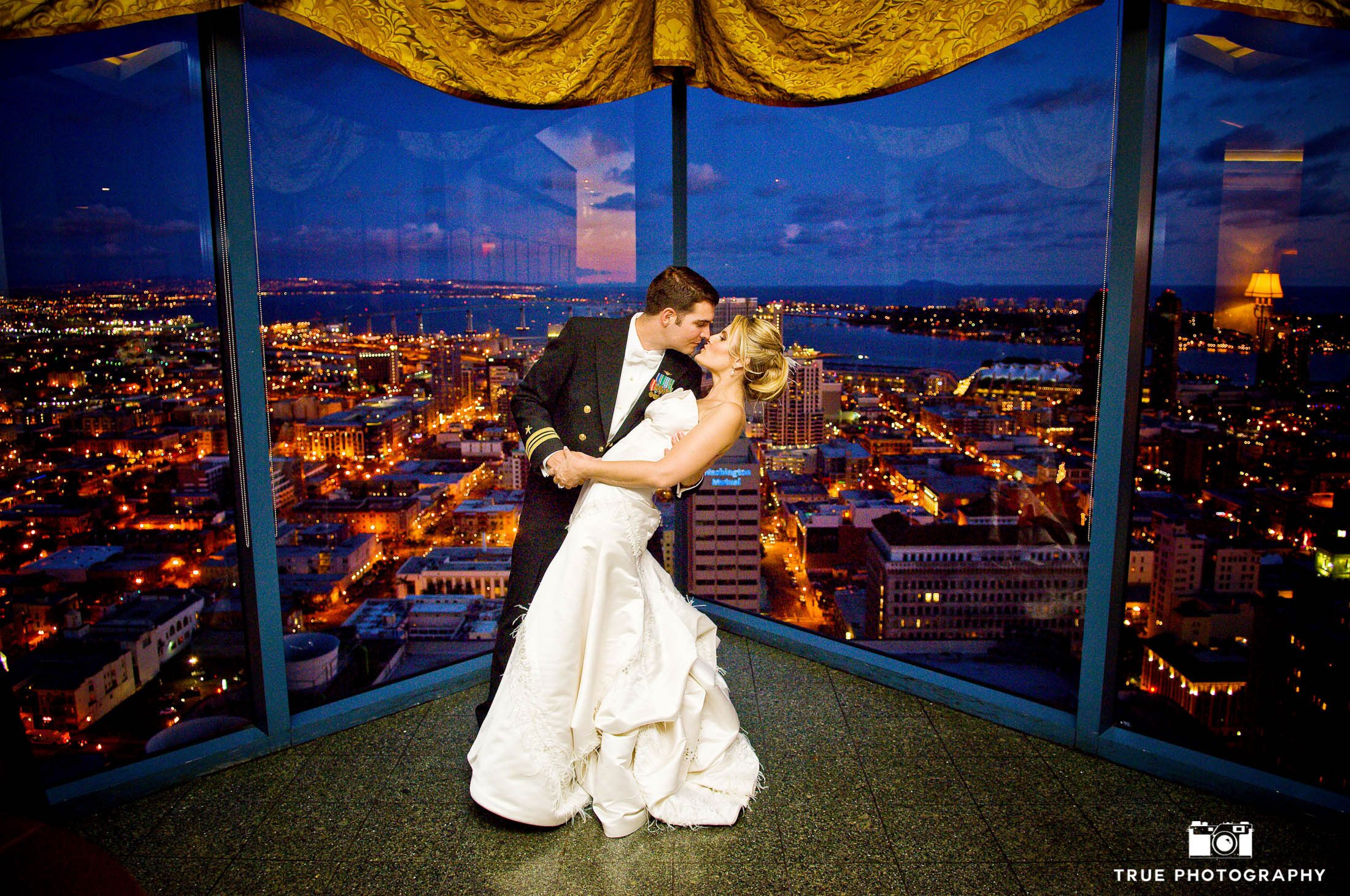 San Diego city night shot overlooking city with bride and groom