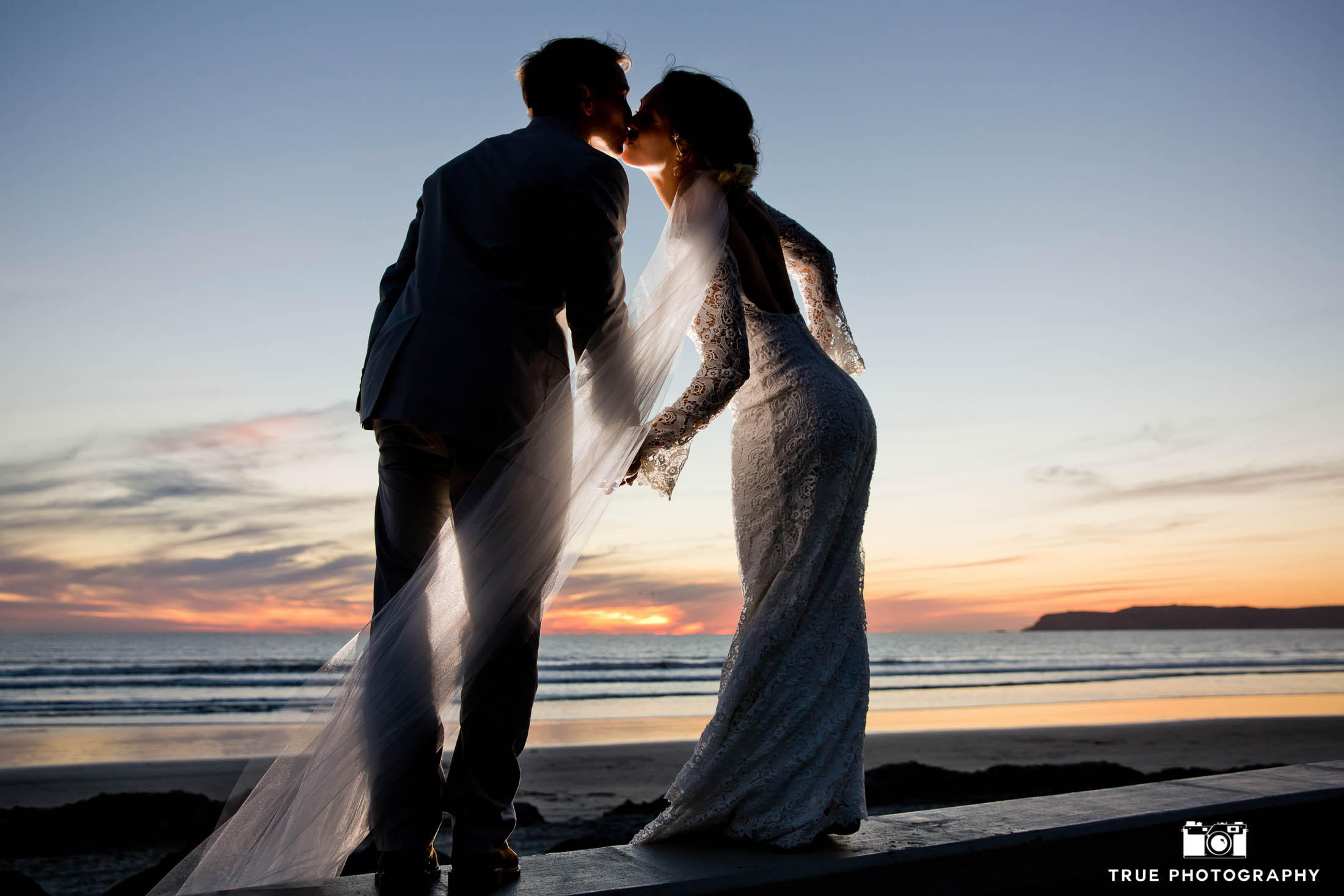 Coronado beach sunset portrait of bride and groom