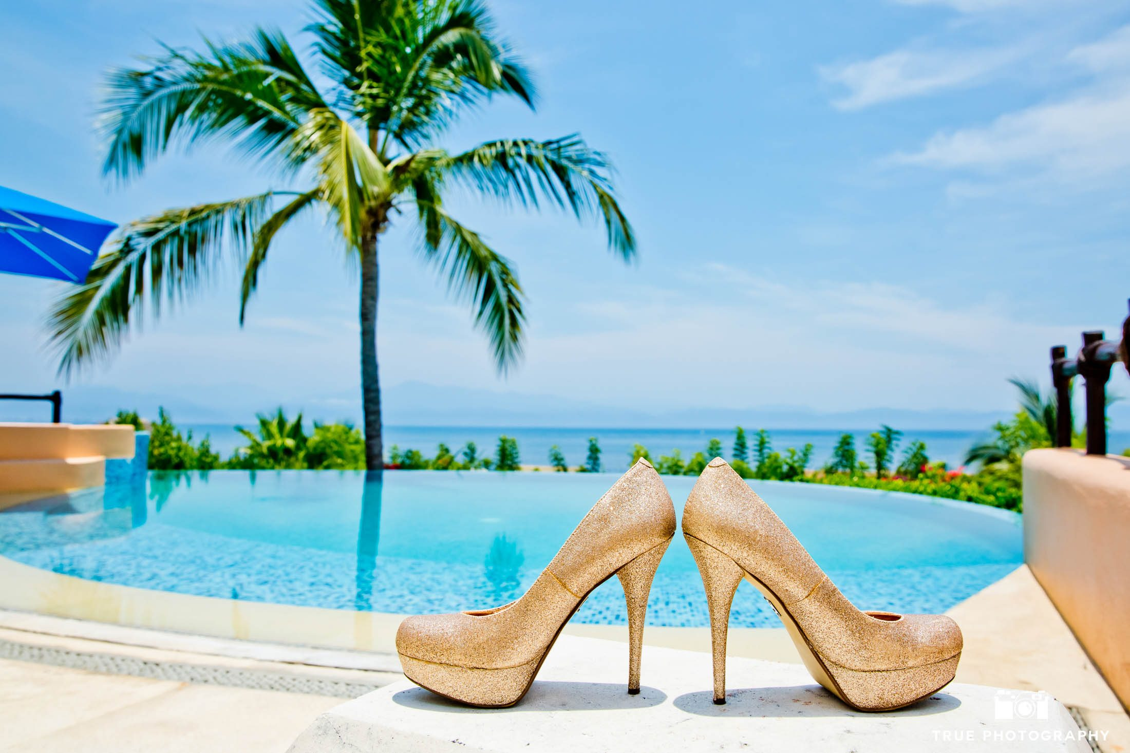 A brides choice for wedding shoes during a tropical destination wedding