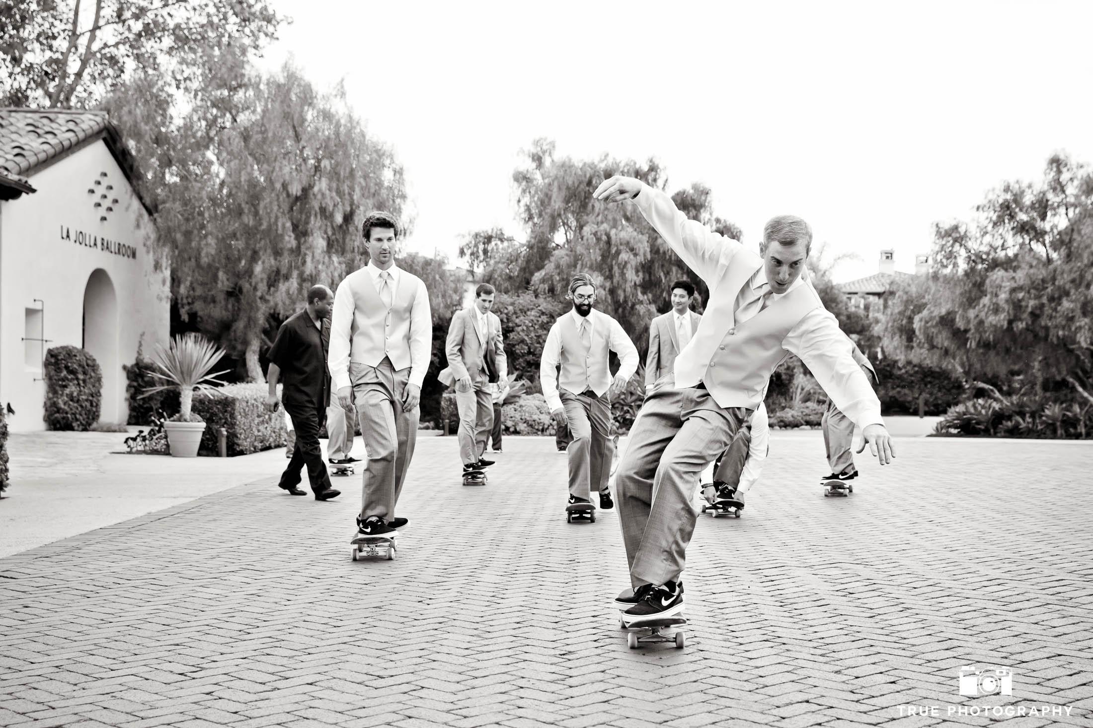 Groomsmen skateboarding down street