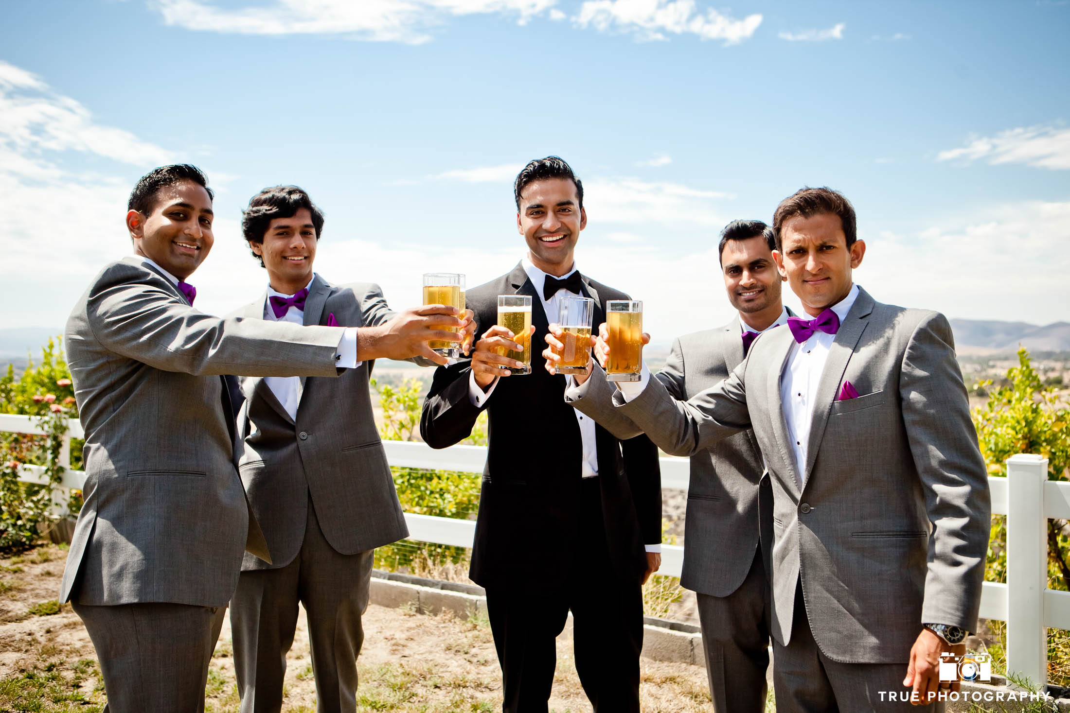 Groomsmen toast with beers