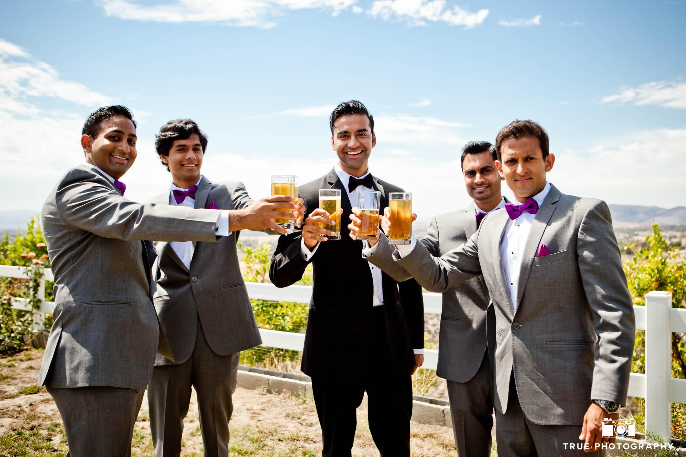 Groomsmen toast with beers