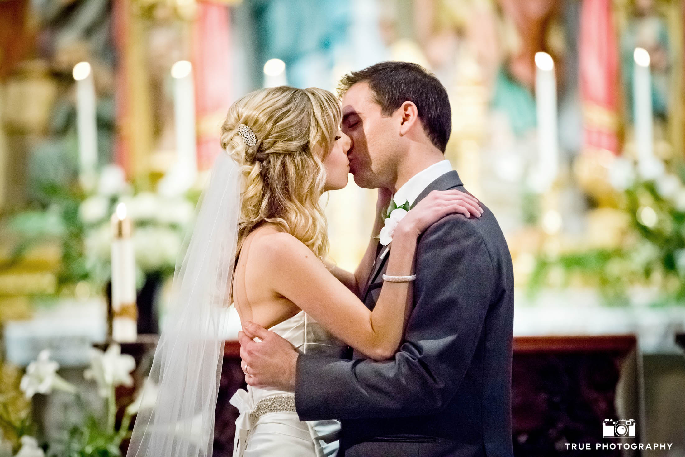 Bride and groom seal the deal with a kiss at Founders Chapel in San Diego