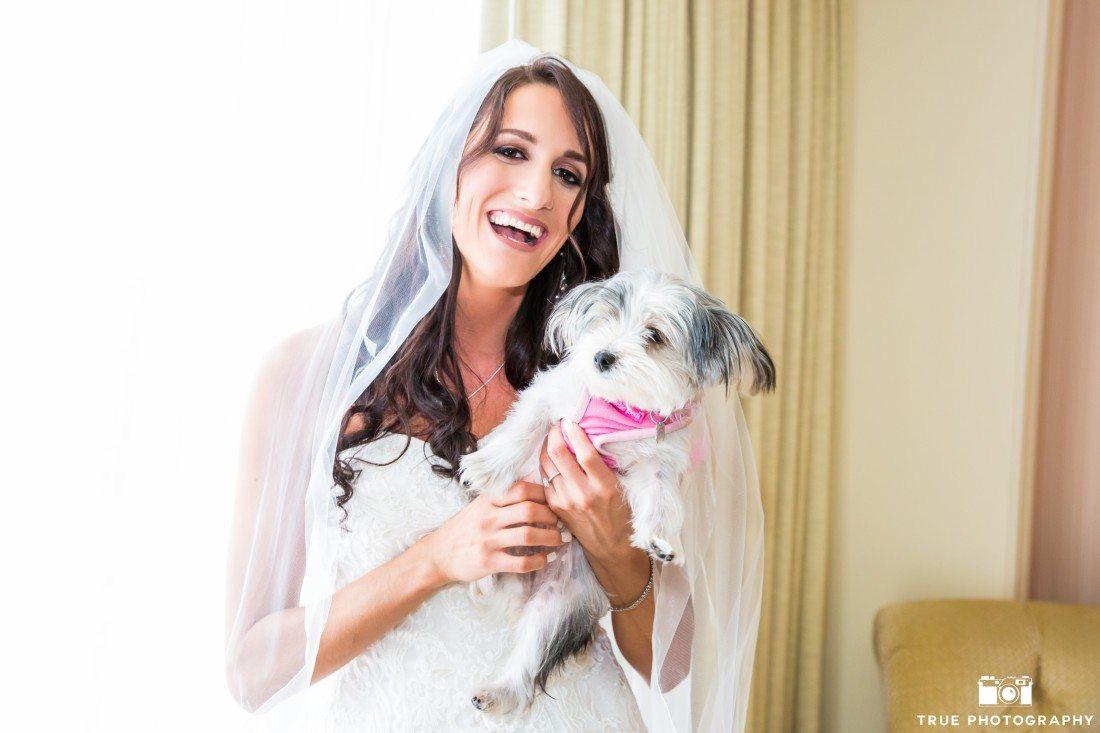 Bride holding her terrier