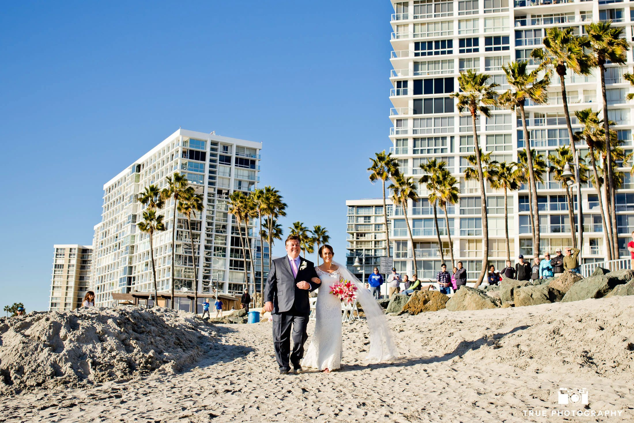 Coronado wedding ceremony with bride and father walking the processional