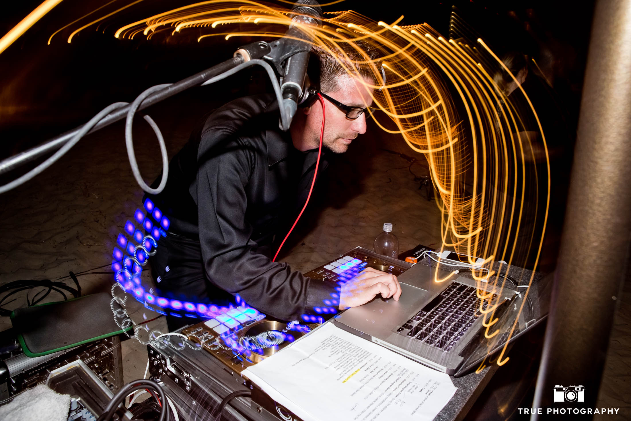 Experimental photo of DJ playing during reception