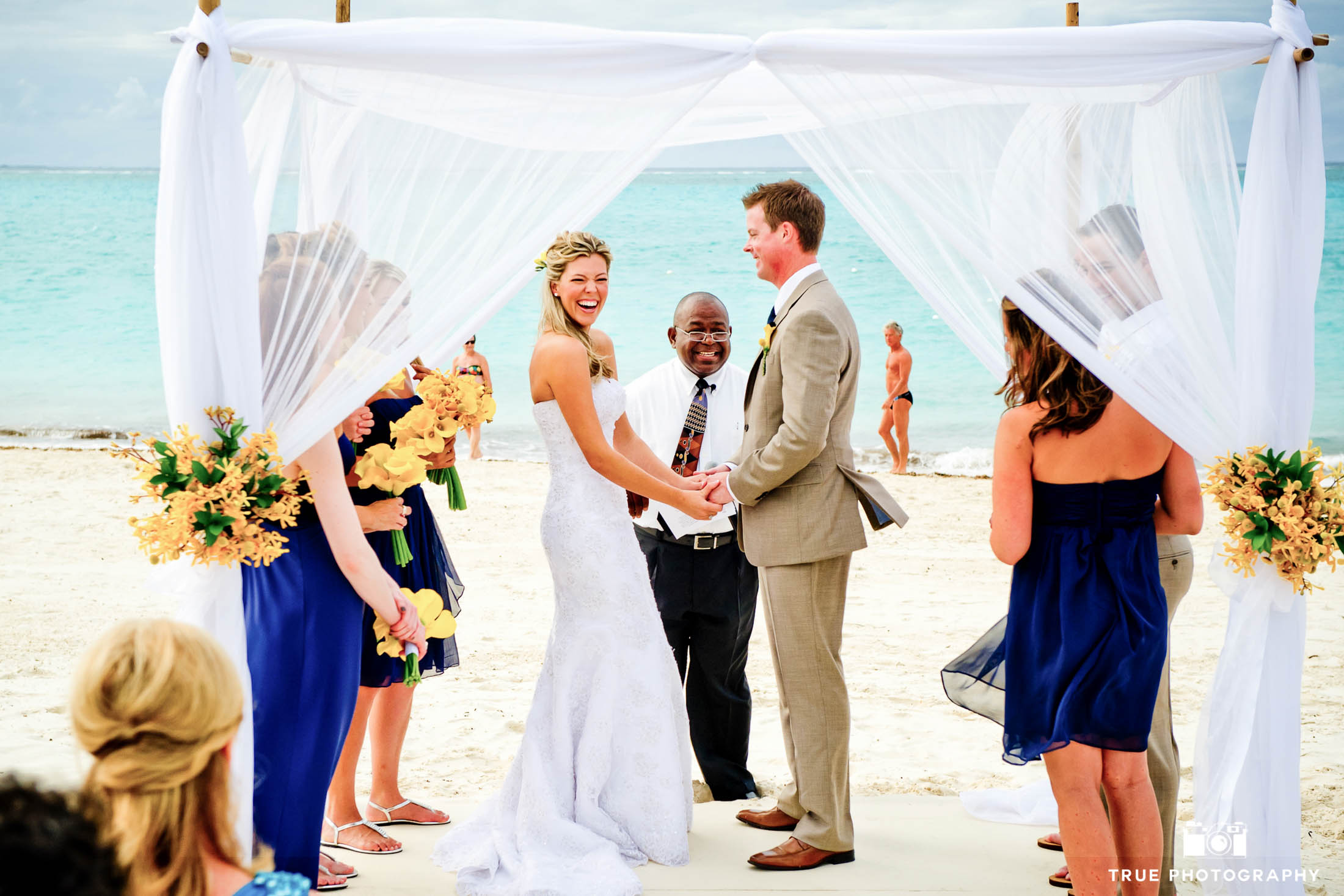 Caribbean ceremony under arbor