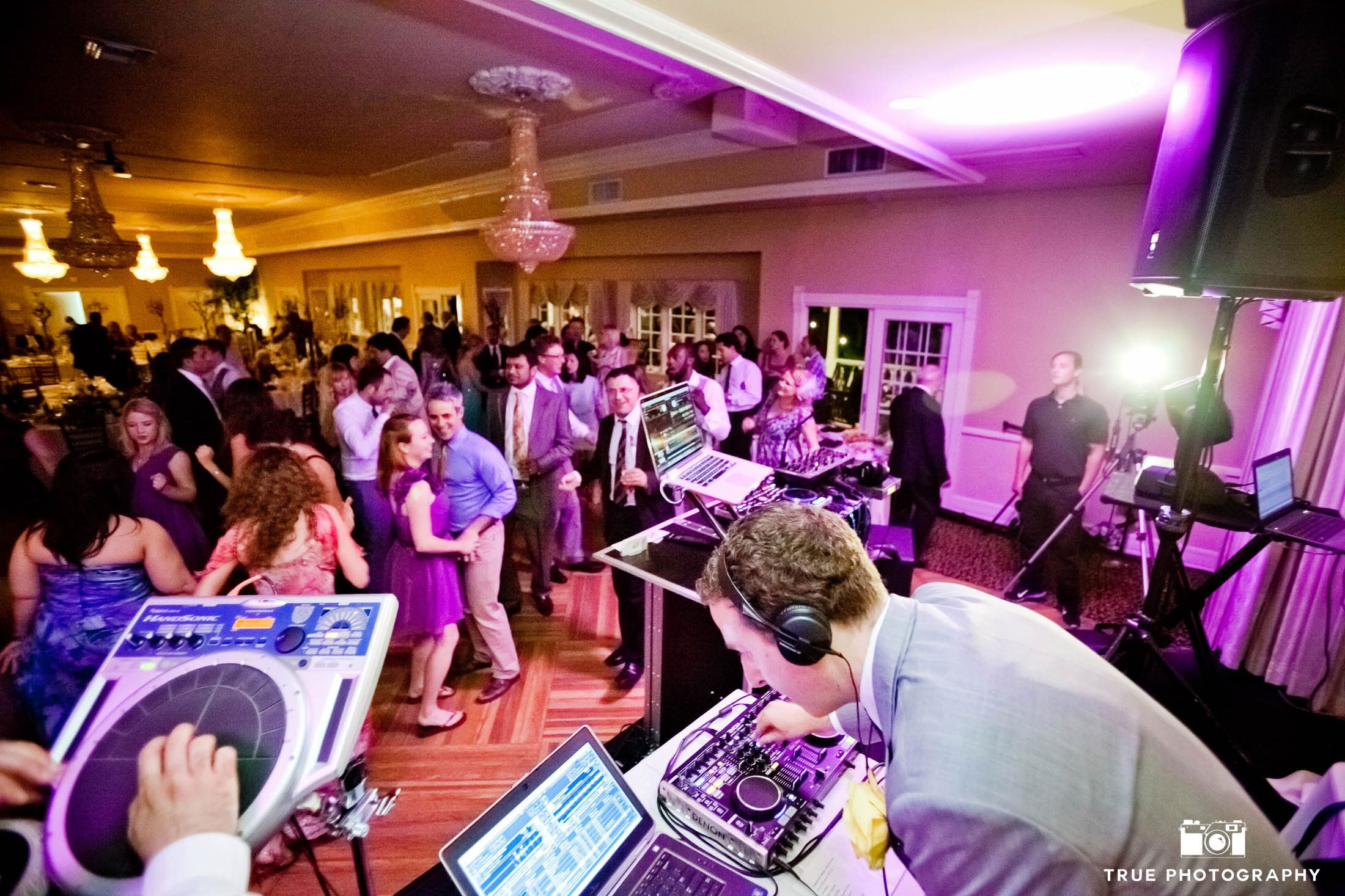 DJ plays music and performs for guests at wedding reception