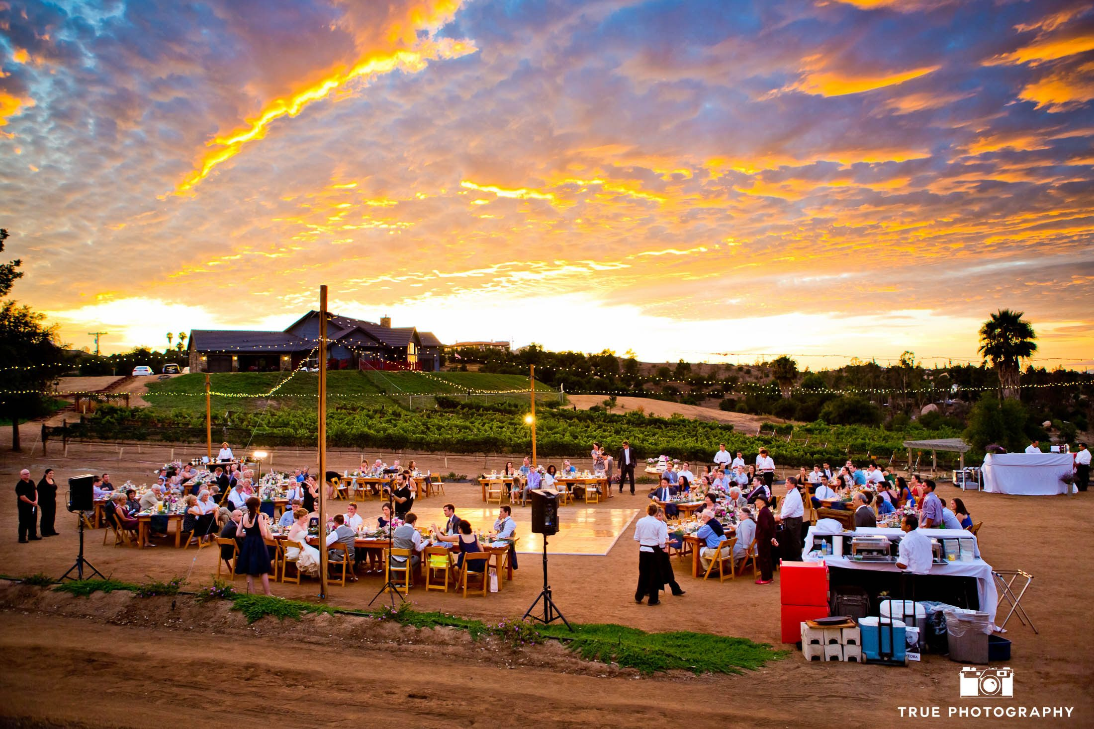 Aerial photo of stunning sunset during reception at vineyard