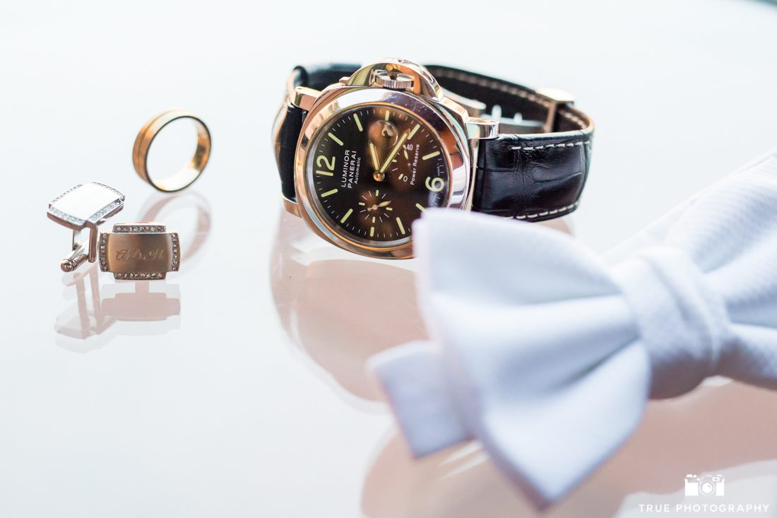 Detail Groom Photo of watch cufflinks and bowtie