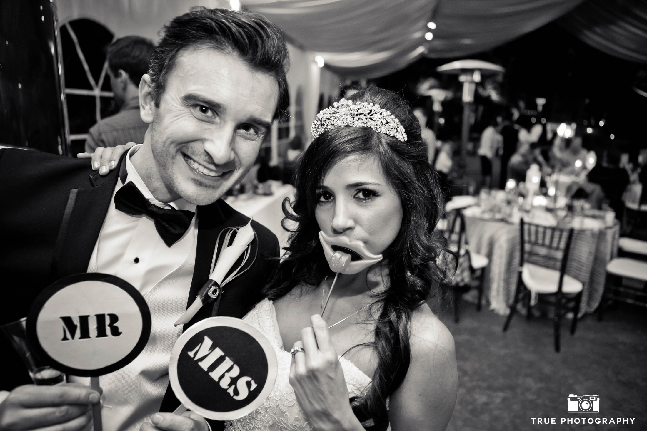 Wedding Couple have fun posing with photobooth props