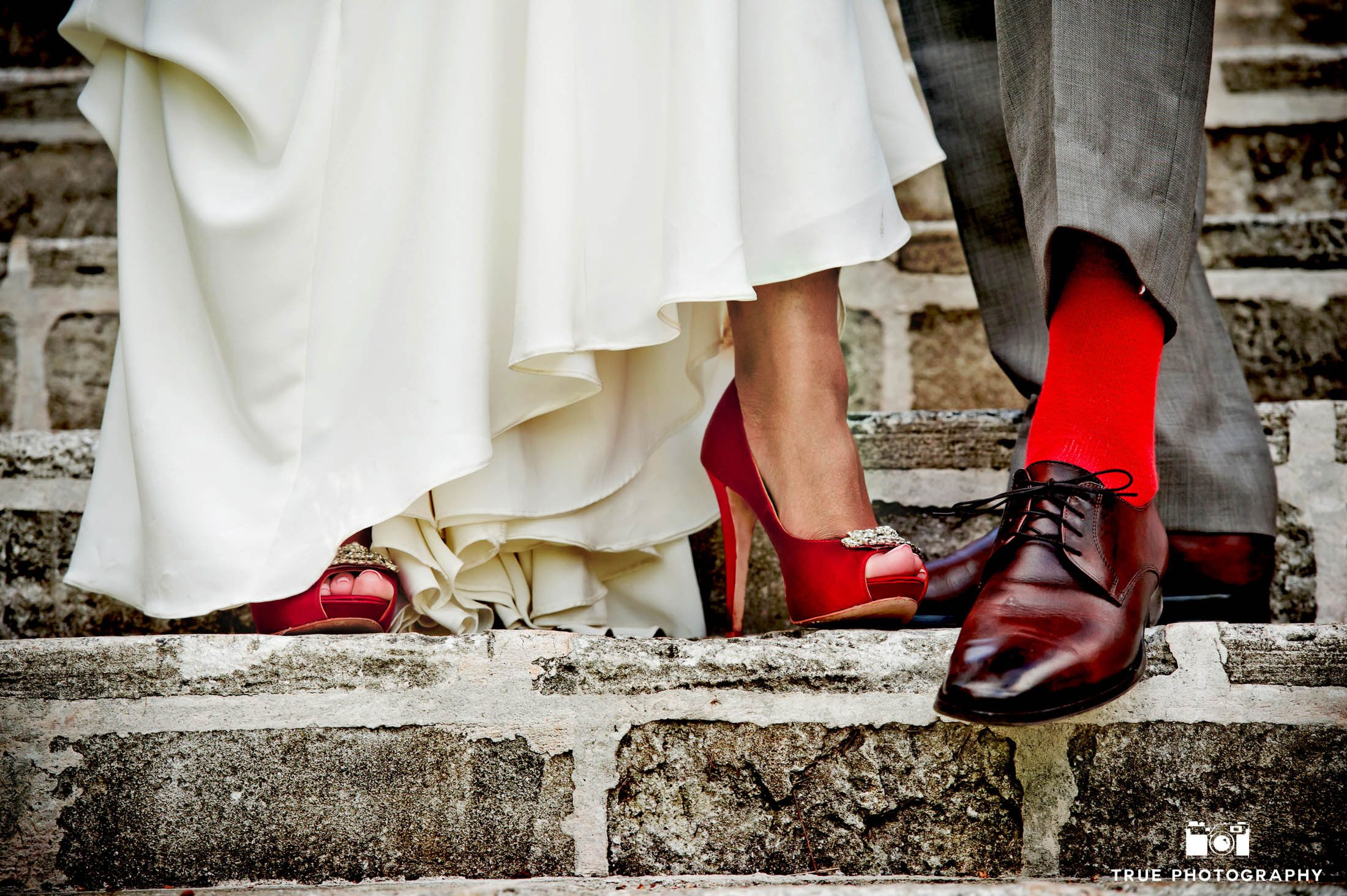 Detail shot of bride and groom's shoes for their caribbean destination wedding.