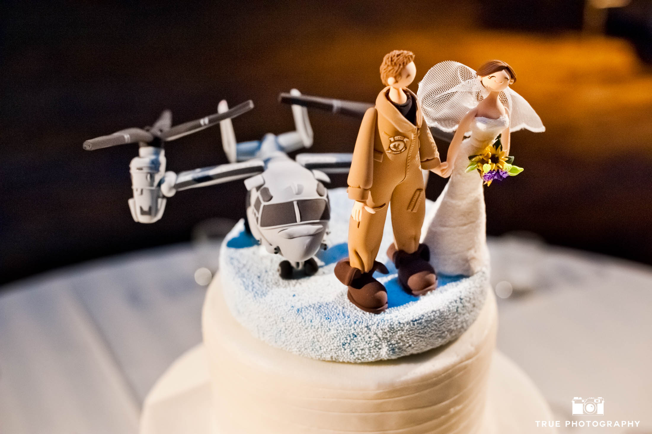 Creative navy-themed cake topper with wedding couple