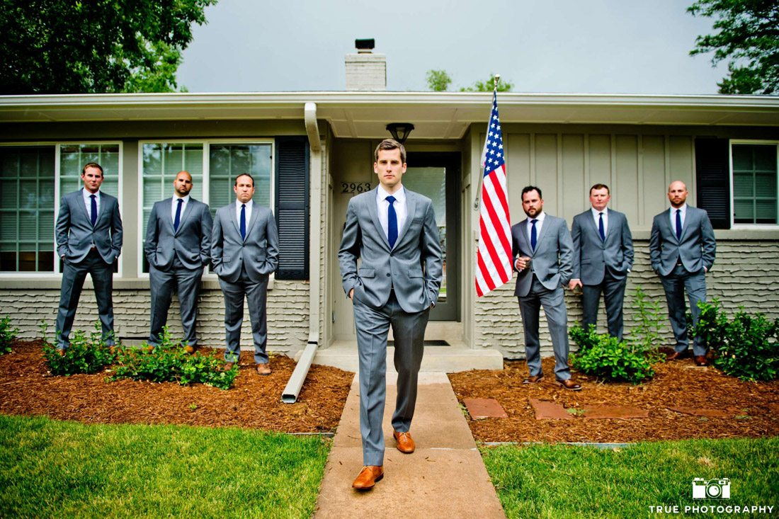 Groomsmen portrait at home wearing slick grey suits