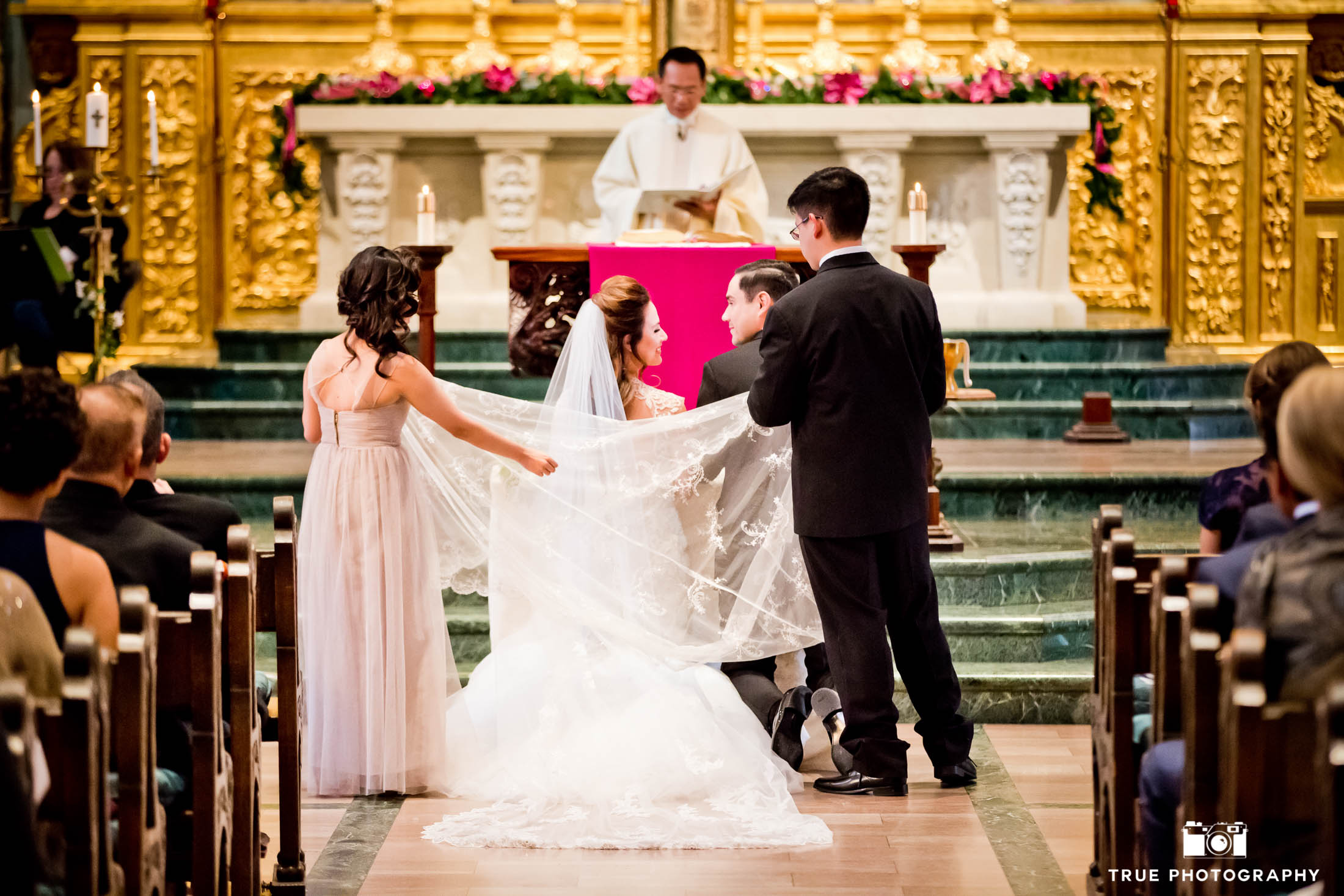 This Catholic wedding incorporates tradition during their USD ceremony.