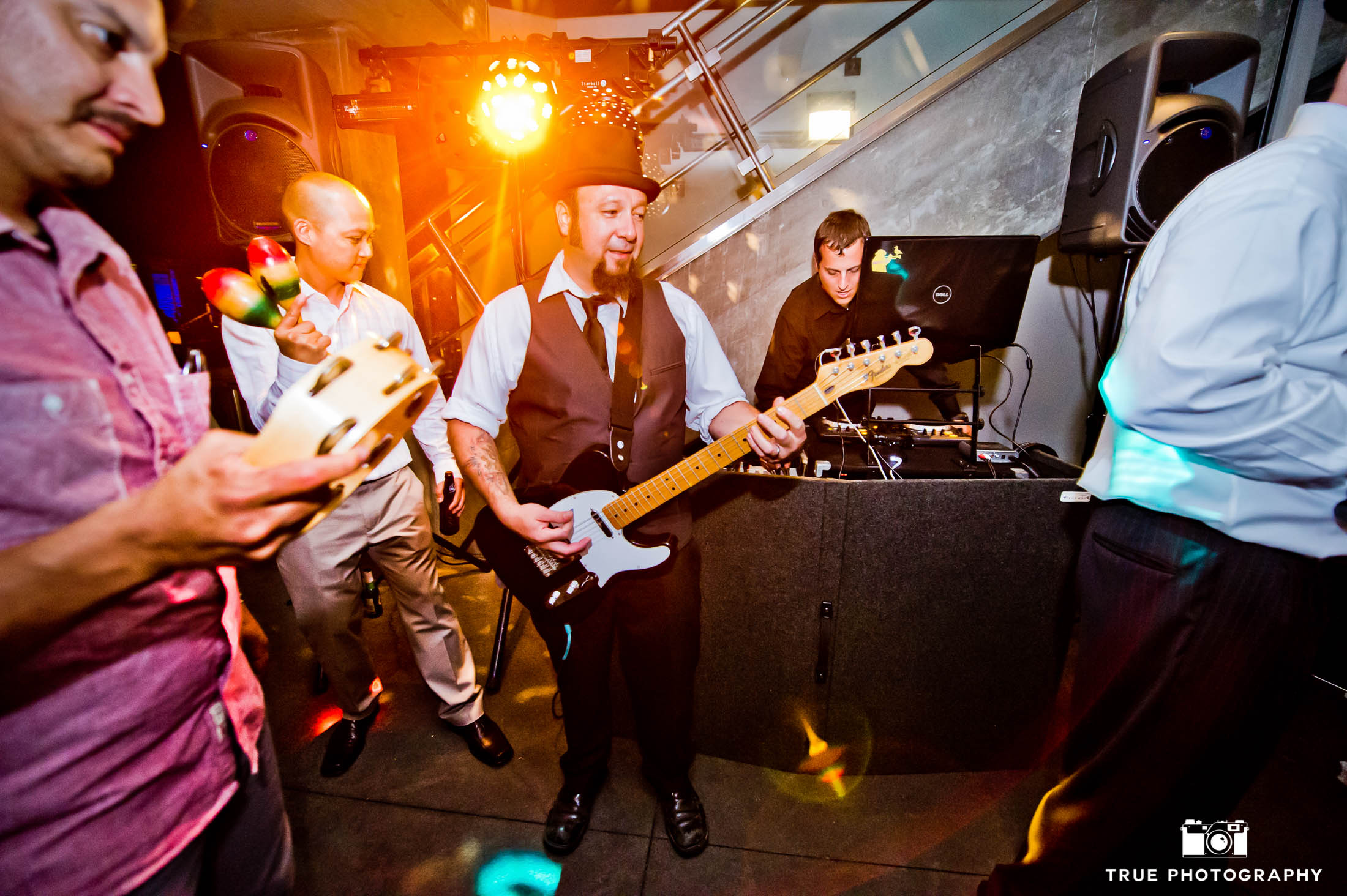 Live band with guitarist playing during wedding reception