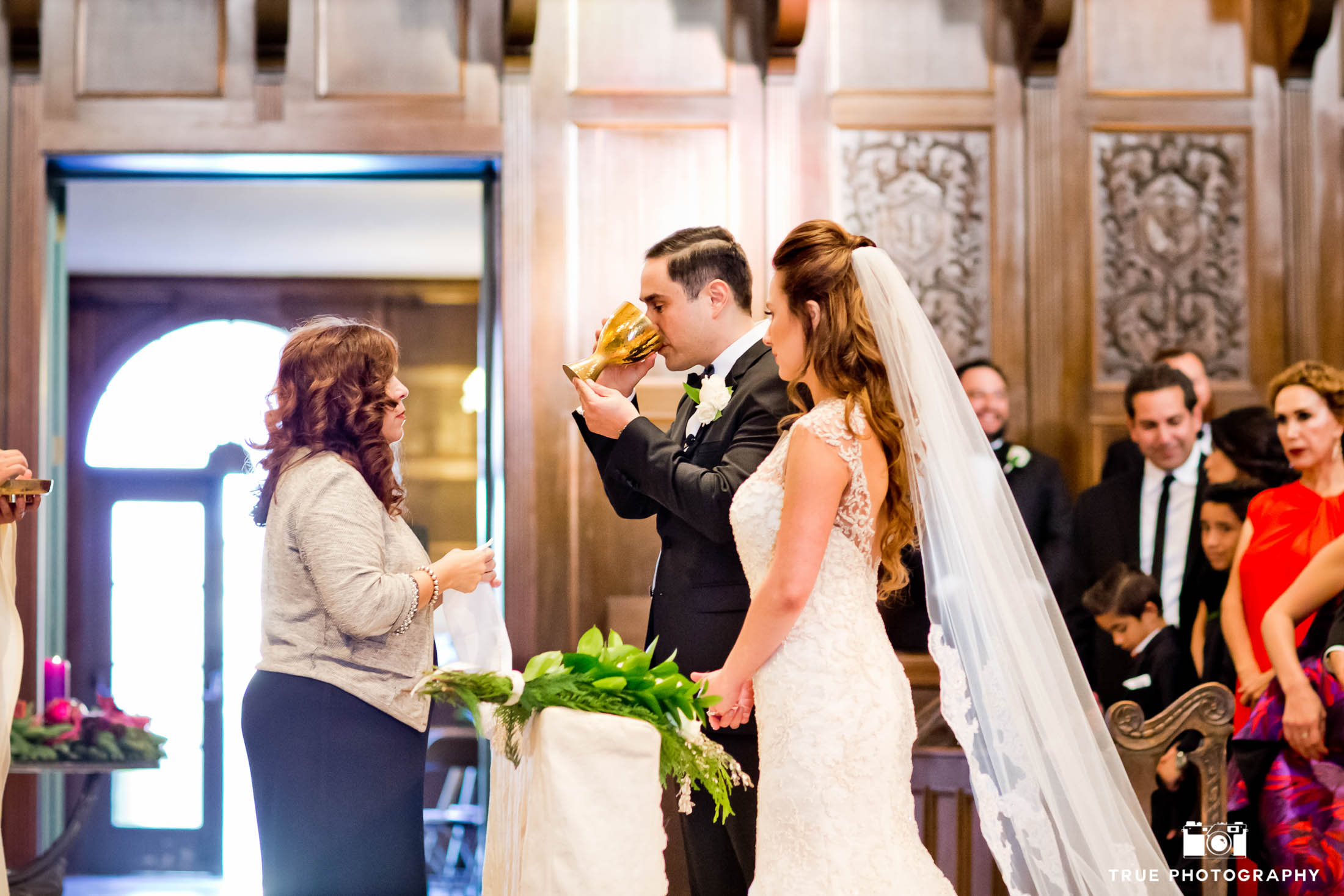 This Catholic wedding incorporates tradition during their Founders Chapel USD ceremony.