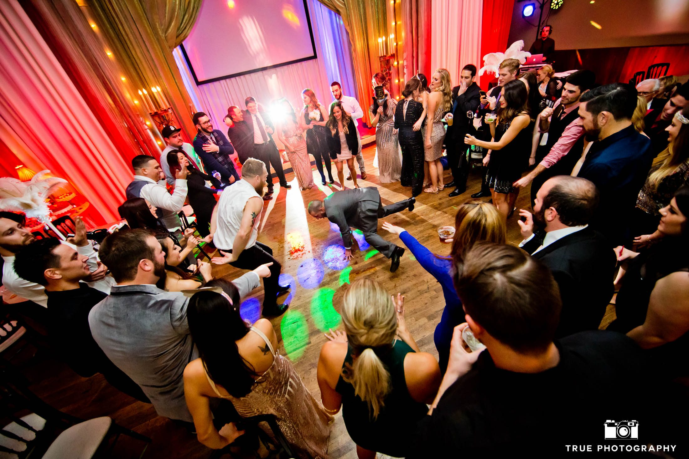 Wedding Guests form dance circle during wedding reception