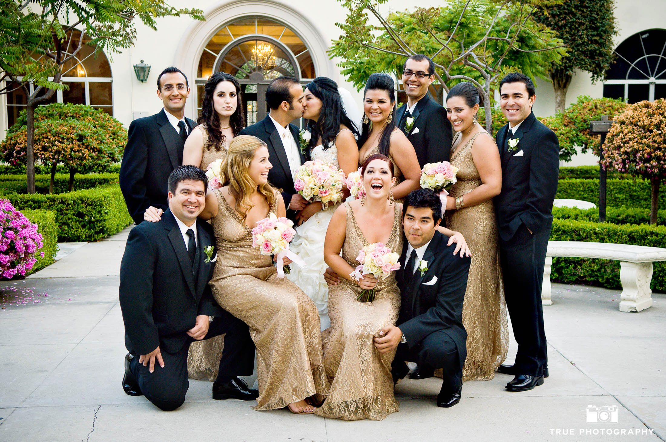 A Bridal Party laughs it up as they take a group photo at the Founders Chapel.