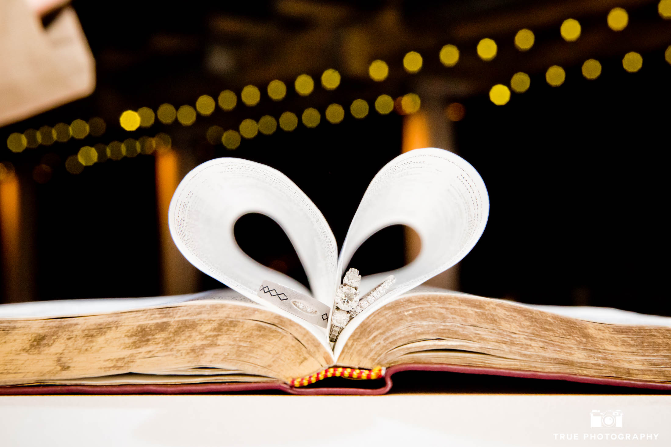Wedding ring shot inside bible